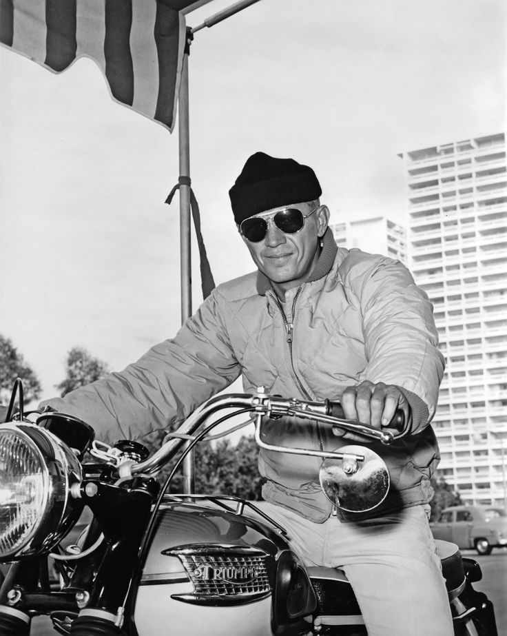 Steve McQueen (ala Triumph Bonneville) on the set of The Sand Pebbles. 1966. S)