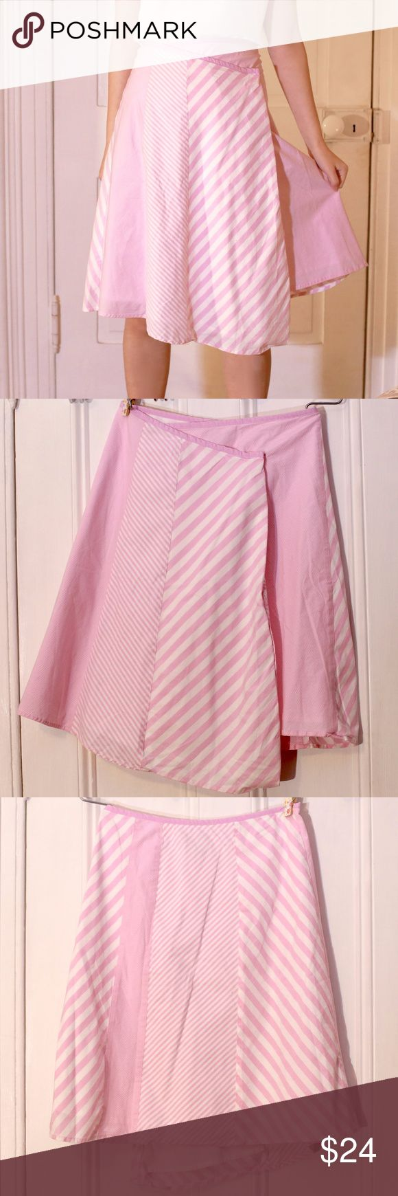 "Anthro Pink Candy Stripe Asymmetrical Wrap Skirt Adorable skirt from Elevenses at Anthropologie. Buttons in the front for an asymmetrical wrap look. Both button in tact and only flaw is a tiny hole near where it fastens (see last pic). In excellent condition otherwise, gently worn. Made up of a patchwork of baby pink and white stripes of various widths. 14.25"" across the waist at the top and 22.25"" in length (knee-length). 97% cotton 3% lycra. Anthropologie Skirts Midi"