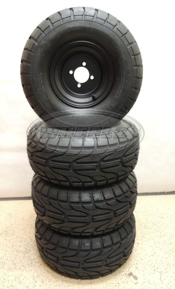 Set of (4) 22x10-10 Golf Cart Street Tires w/ Black Steel Wheels w/ Centercaps