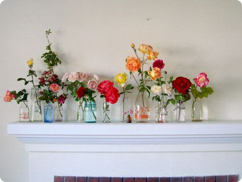 i want this on my mantle someday. need to plant more rose bushes i suppose :)