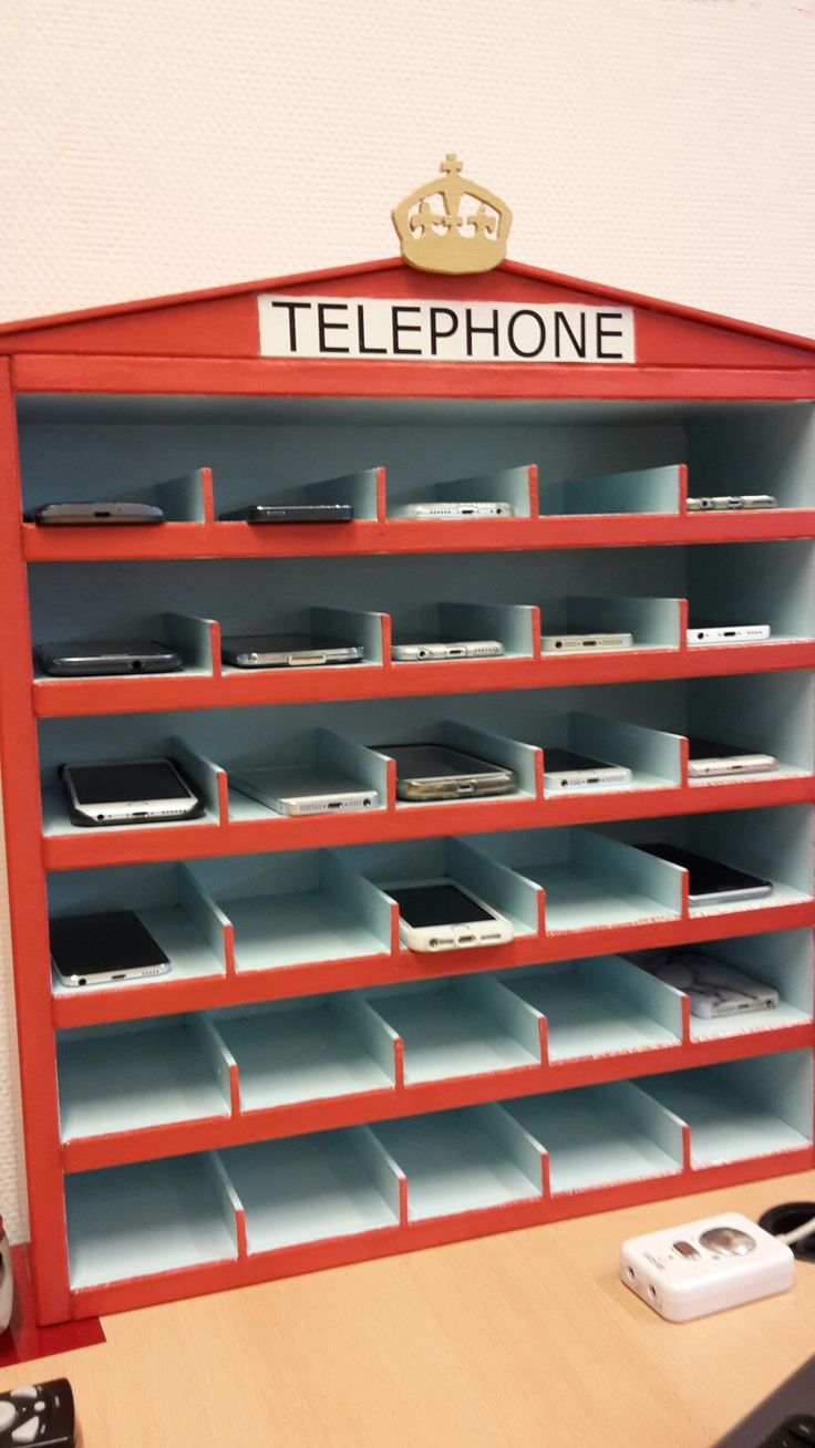 Mobile phone hotel for my English classroom. When asked (e.g. during tests) students put their phones in their 'room' of the hotel so they will not be able to use them when not allowed.
