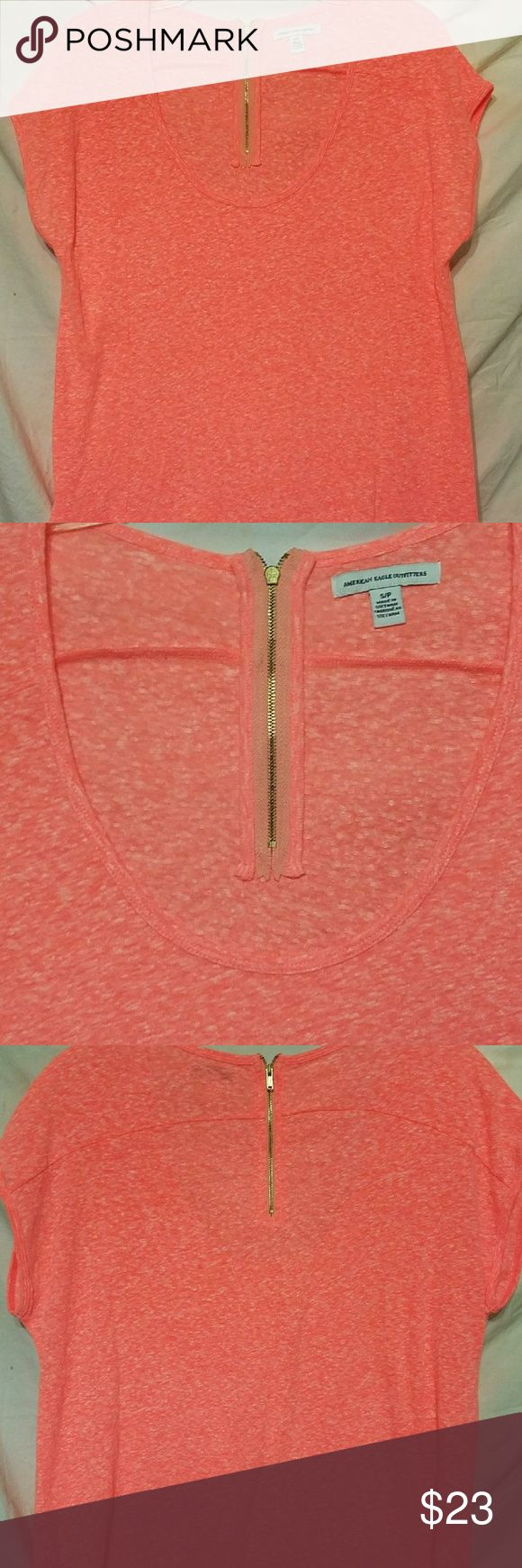 Short sleeve shirt American eagle t shirt Gold zipper in the back Great condition Little bigger than listed size. Could fit medium size American Eagle Outfitters Tops Tees - Short Sleeve