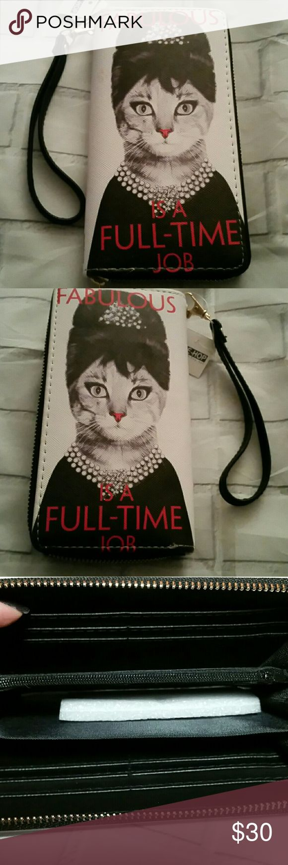 NWT Fabulous is A Full Time Job Wallet Wristlet NWT Fabulous is A Full Time Job Wallet Wristlet with a zip around,  hand strap that clips off  and inner zipper and tons of card and other slots. There is a tiny mark on the front on the front as seen in the last photo. Made in China for a British company in faux leather ALE-HOP Bags Wallets