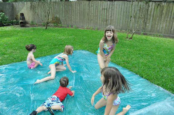 Make a WATERBLOB for your kids!  Fold 3mil plastic in half, tape 3 sides with duct tape (leave small opening for hose), fill it up, add food coloring, glitter, rubbery toys that won't tear the plastic. Spray the top with water for an awesome slip and slide. Great toddler party idea