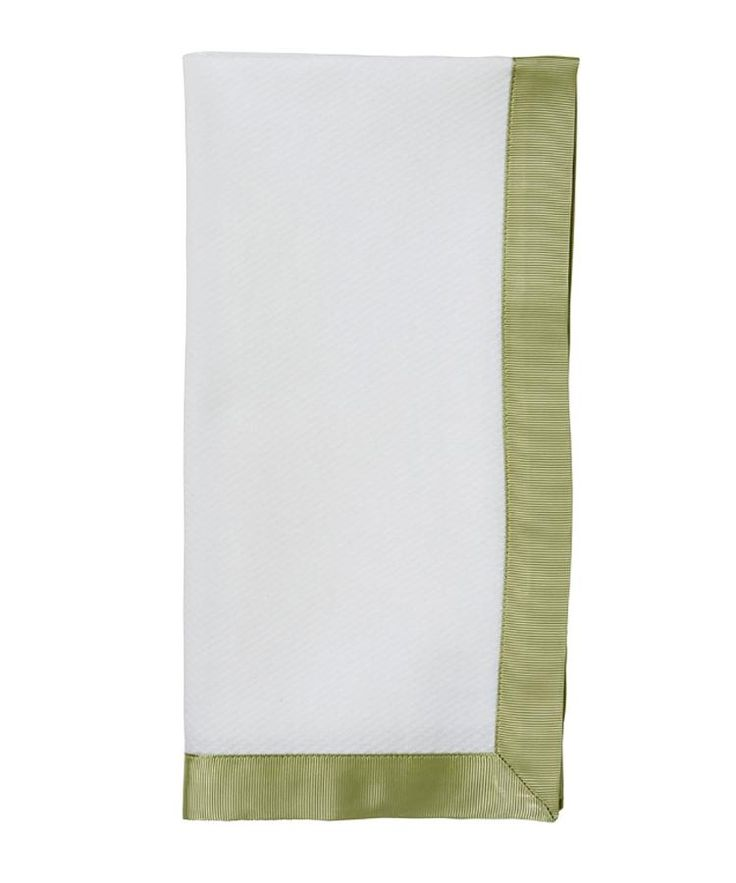 Ribbon Pique Pistachio Green Napkin - The perfect balance of warm and cool for limpid summer days and sophisticated winters by the fireside, the bold ribbon border on this clean white linen dinner napkin has the sheen of an evening gown and the simplicity of sportswear, making it an ideal all-occasion accessory for your table setting. The Ribbon Pique Napkin in Pistachio Green is a staple of gracious living.