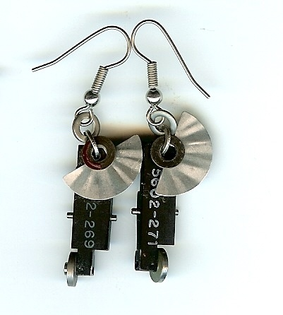 Felice's Pieces: Earrings made from upcycled aerial reconnaissance camera parts and answering machine parts.