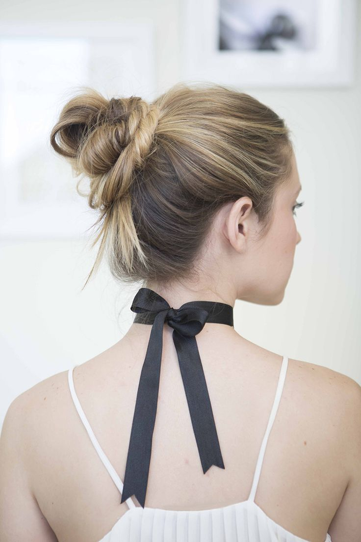 Black ribbon threaded through braid -- so pretty