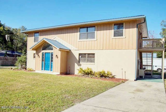 REDUCED! 3BR/2BA 2-story home ... on over a 1/3 acre in the heart of Ortega Farms close to NAS Jax, minutes from downtown. Features enclosed parking for up to 5-vehicles! Attached twin 1-Car garages with additional 24'x36' (864sf) detached 3-car garage/workshop with separate electric meter. Great for the car enthusiast, boat owner or craftsman. Private access from separate side road.  RV Parking with 50-amp connection. Open & spacious floor plan. Two BRs & one bath downstairs. Upstairs…