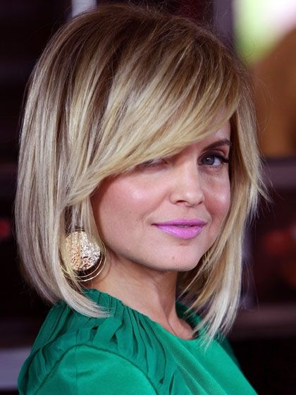 An angled bob with sweeping bangs and piecey ends is way more playful, and more appropriate for American Reunion. To copy her style, blow-dry hair straight and lightly roll the ends between your fingers with a touch of Wella Professionals Texture Touch Reworkable Clay. sizzlefizzle