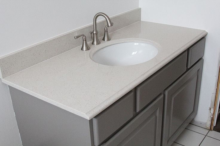 HOW TO PAINT BATHROOM CABINETS - withHEART.  Benjamin Moore Advance paint and it made me a believer.  I tested several colors and settled on Galveston Gray in satin.  It's a true gray– without much blue undertone.