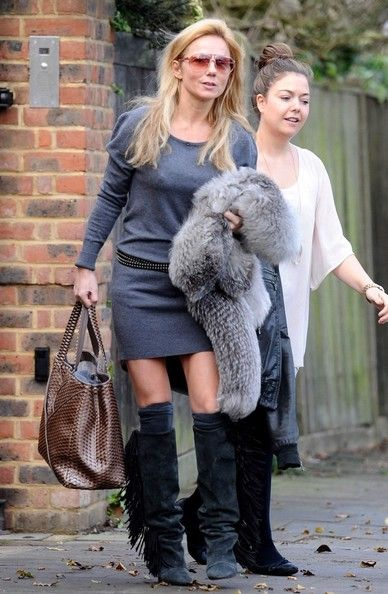 Geri Halliwell Geri Halliwell leaves her home wearing fringed boots.