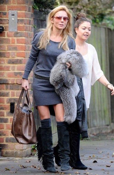 Geri Halliwell Geri Halliwell leaves her home wearing fringed boots.