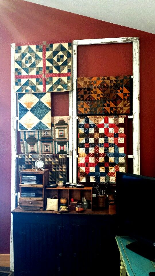Remove the glass and use  old windows to display quilts.