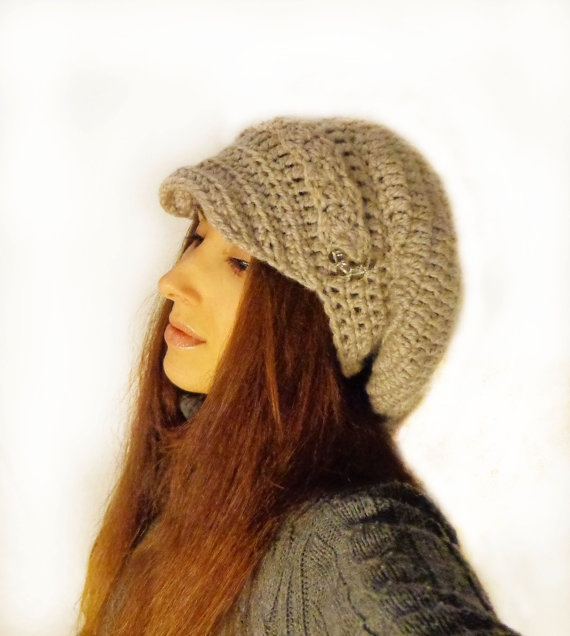 Handmade Crochet newsboy slouchy hat, with crystals on the sides, very elegant and different than other hats. Fits all sizes.  The color is that of rock, with silverish touch.  Its wool blend and alpaca yarn, very good quality yarn.    Hand wash in lukewarm water ad lay flat to dry for best care.