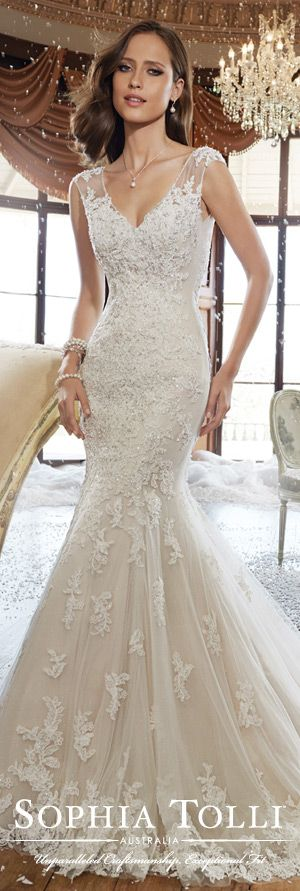 """You are going to love """"Alex!"""" This bliss tulle trumpet gown by Sophia Tolli features hand-placed shadow box lace appliqués and a lovely V-neckline with cap sleeves. A stunning chapel length train completes this glamorous look. Twenty-one more gowns from her Fall 2015 Collection await you! #weddingdresses"""
