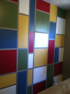 Square and rectangle pattern i painted on a bedroom wall - Bedroom layout ideas for rectangular rooms ...