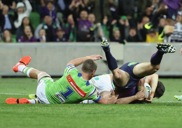 Cooper Cronk Photos Photos - Cooper Cronk of the Storm scores a try during the NRL Preliminary Final match between the Melbourne Storm and the Canberra Raiders at AAMI Park on September 24, 2016 in Melbourne, Australia. - NRL Preliminary Final - Melbourne v Canberra
