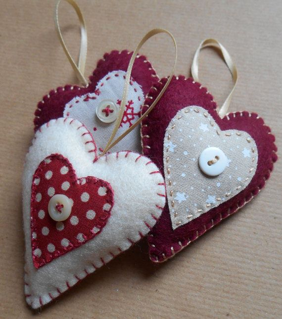 Hey, I found this really awesome Etsy listing at http://www.etsy.com/listing/167657109/set-of-three-heart-shaped-felt-christmas