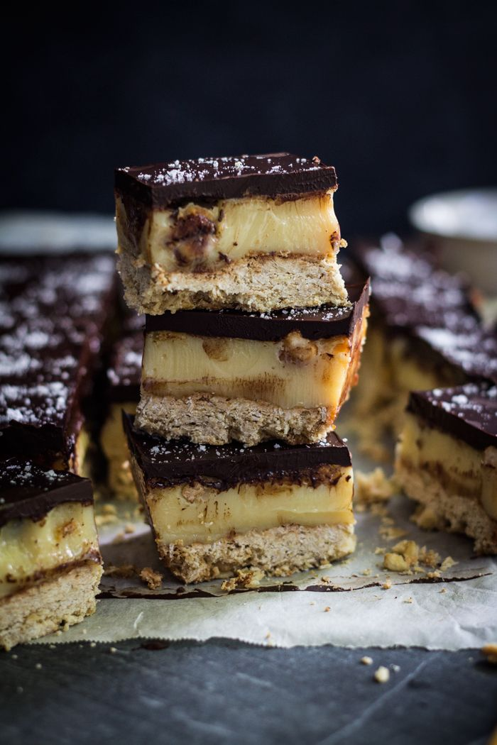 salted caramel hazelnut slice; amazing chewy oatmeal cookie crust, topped with an amazing gooey, thick, rich caramel filling made with condensed milk, butter, and golden syrup studded with hazelnuts; topped with a salted dark chocolate ganache
