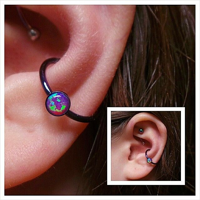 Here's a fully healed conch piercing switched up to this cbr with a 4mm pink opal captive gem bezel from @anatometalinc anodized dark purple in house at @Pincushns. Looks fancy doesn't it! #conchpiercings #piercedconch #pinkopals #anodizingisawesome...