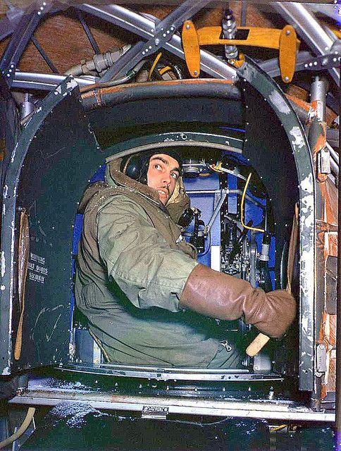 Nose gunner in the cramped conditions of the Frazier-Nash front turret of the Vickers Wellington bomber, with it's two .303 machine guns - RAF - World War 2