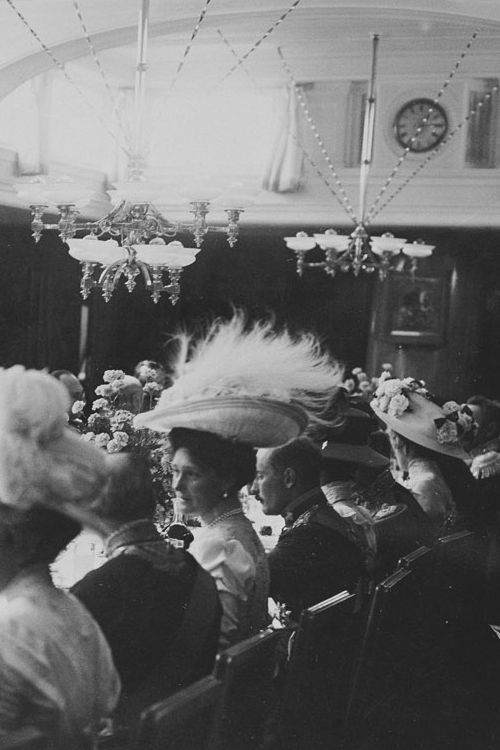 Empress Alexandra Feodrovna. You probably didn't ask her to remove her hat!