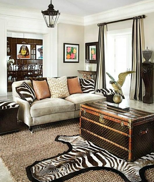 sofa dressed with cat pillows ~ and zebra rug