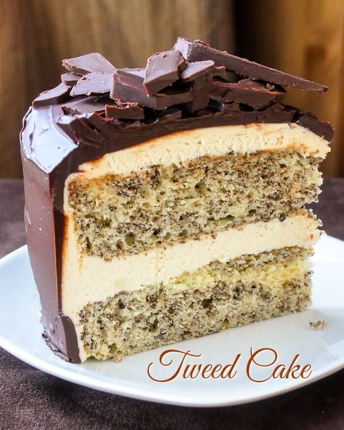 This tweed cake is flecked with chocolate, frosted with vanilla buttercream & glazed with chocolate ganache. Based on a favorite Newfoundland cookie square.