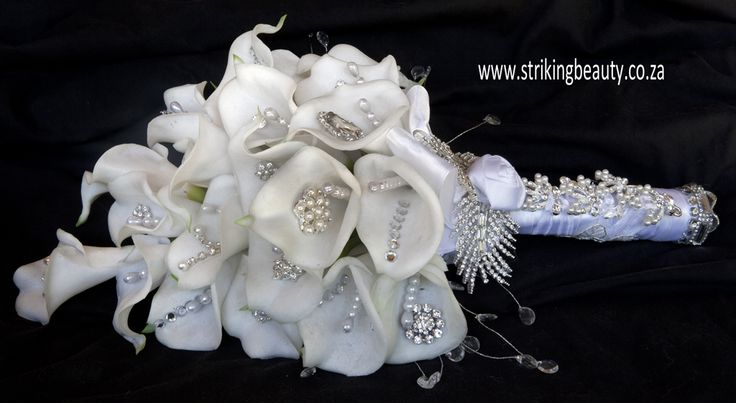 Calla lily brooch bouquet - unusual and beautiful with jewelery accents and detailed handle. Stunning.