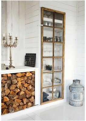 Indoor log storage in a shelving unit in kitchen/sunroom - could this be included in the kitchen between the back door and new door to sunroom? Perhaps with display shelves above?