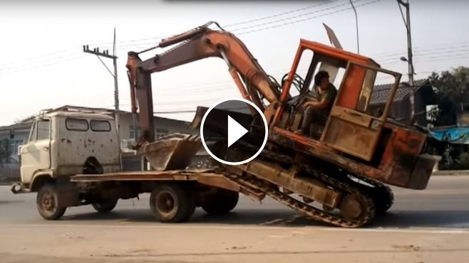 How to Load a Big Excavator On a Small Truck Like a BOSS - Thailand STYLE - According to the size of excavator (most likely, it is an old Kubota excavator), Loading