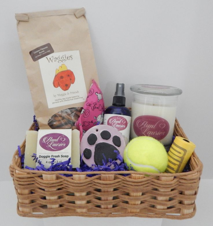 """Just Dogs"" Gift Basket, Medium, featuring all natural spritz, doggie soap, and dog biscuits. Also includes ball, clean-up bags, pet odor candle, and bandana."