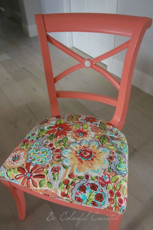 Colorful dining chairs. Traditional side chair painted with Benjamin Moore Fan Coral and reupholstered.