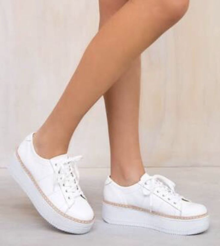 Simple white leather platform casuals with nude trim add height whilst remaining practical for day activities. Very cute look with shorts, skirts and dresses.  Photo credit: princesspolly.com