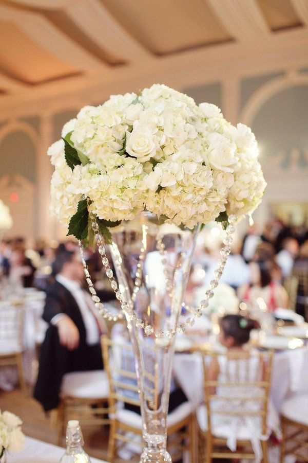 """hydrangea and rose tall centerpiece. Use a skinnier trumpet vase, go over your guests heads.  Have some flowers at the base to """"weigh"""" it down."""