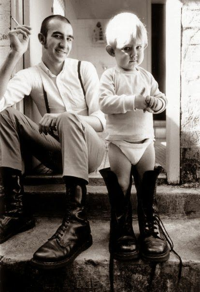 Family matters. Young skinhead dad and son.
