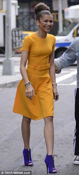 The runner-up wears Prada: The 16-year-old starlet looked lovely in her mustard belted dress, which she paired with a massive top-bun and violet Giuseppe Zanotti booties