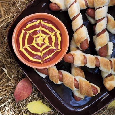 Halloween Recipes: Mummy Dogs  | Along with a spider web of mustard and ketchup, Mummy Dogs create the perfect display for any Halloween party.