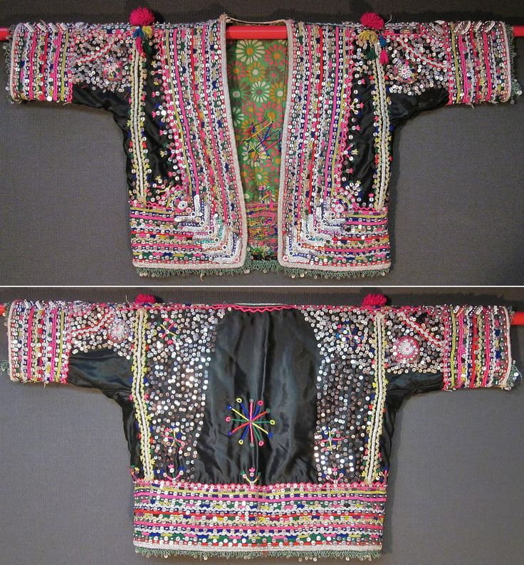 A 'pullu cepken' (jacket) from the Pomak villages near Biga (Çanakkale province), mid-20th c.  Part of a festive women's costume.  Satin fabric, adorned with cotton embroidery, silver and gold zigzag ribbons, silvery cord, metallic & mica sequins, small glass beads, (cotton or orlon) pom-poms, buttons.  Edged with (mixed cotton & lurex) 'oya'/lace, combined with sequins.  (Inv.nr. cep060  - Kavak Costume Collection - Antwerpen/Belgium).
