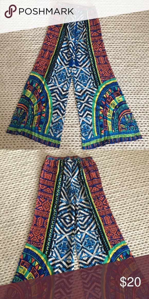 NEW wide leg printed palazzo pants S NEW wide leg printed palazzo pants. Size small. Factory direct. New, never worn. Perfect beach/pool cover up. Boho chic! Flying Tomato Pants Wide Leg