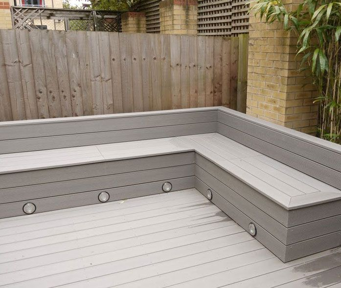 Michael Greenall | Decking in Poole. Corner seating with storage for cushions and built in lighting, pool deck