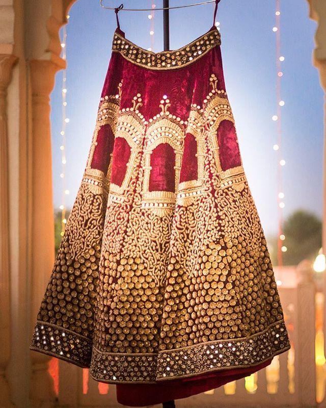 We are crushing over bride Abhilasha Meena's velvet lehenga with jharokha details in gold embroidery by @asianacouture_delhi. Photo Courtesy- @happyframesphotography (Delhi) #velvetlehenga #redlehenga #jharokha #lehengalookbook #bridaljewellery #candidshot #bride #indianbride #wedding #indianwedding #weddingsutra #bridallook #dday #bridalshoot #traditional #indianwedding #WeddingSutra #coolbride #gettingreadymoments #bridegettingready #candidphotography #lehengadiaries #desibride #southasian