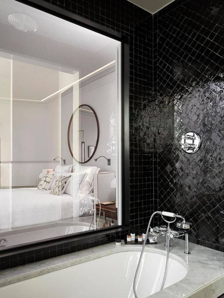 11 beautifully detailed places that are inspiring us right now black tile bathroomsblack tilesparis lovedesign