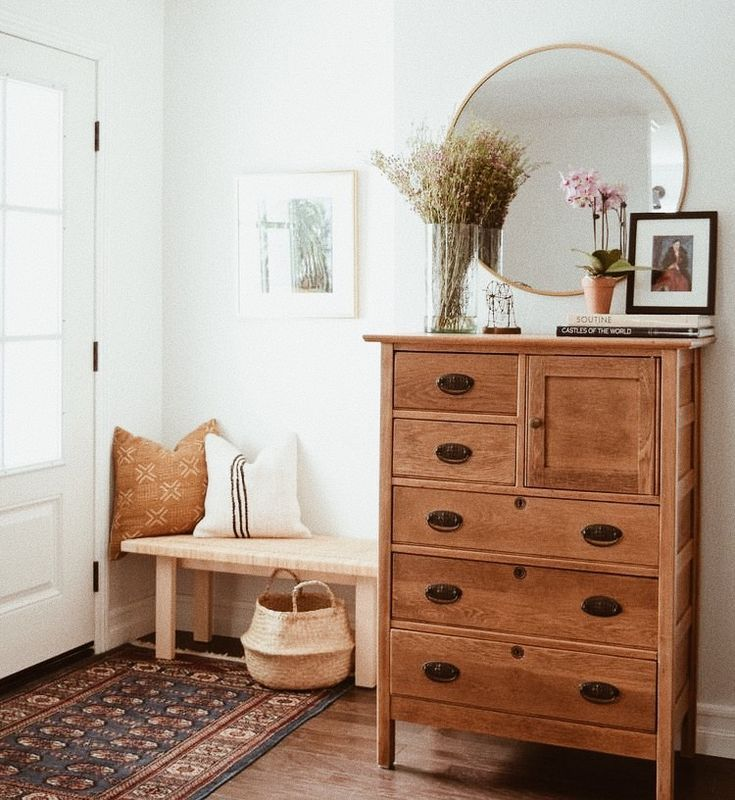 Wood dresser at entryway. Bench