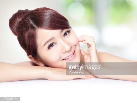 Stock Photo : beautiful woman face with health skin and teeth