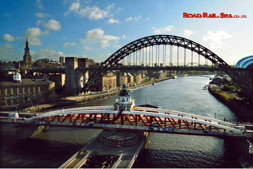 View along the Tyne towards the famous Tyne Bridge. Newcastle, United Kingdom. Travel to Newcastle in just 3 hours by train or stay overnight before catching the ferry to Amsterdam with DFDS.