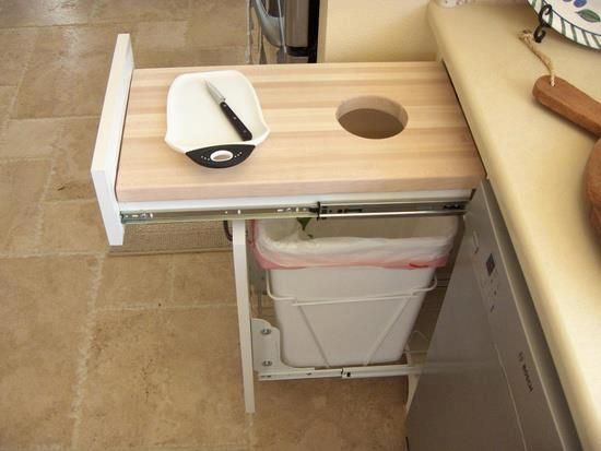 Need this in future house. Chopping board with trash can underneath!