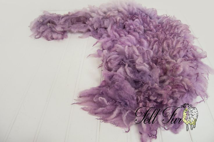 Long woolly garland.Hand washed and dyed sheep's fleece. Fluffy light purple locks, lilac, light lavender with darker tips. Natural low lights and highlights.Approx measurements: 150 x 30cm (59 x 12 Inch)Colour disclaimer: While every effort is made to represent colours accurately, every monitor is different and we cannot guarantee the colours you see exactly match the colours of the actual fibres.For reference the bowl used in the images is 40cm (15.75in) in dia...