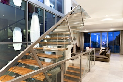 Custom Stairs - this floating staircase creates and amazing feature in the middle of this luxury home