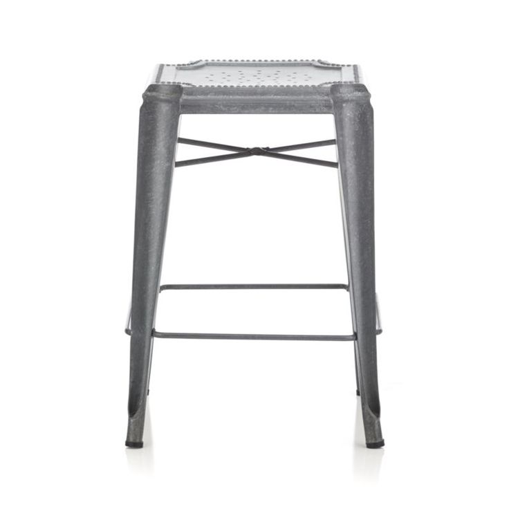 Crate & Barrel Galvanized steel stool is crafted with unique reverse-arched legs and distinctive beading and decorative perforations.  The hot-dip galvanizing process creates random formations of spangles, and each stool gets a dose of hand distressing, ensuring that each piece is truly unique.